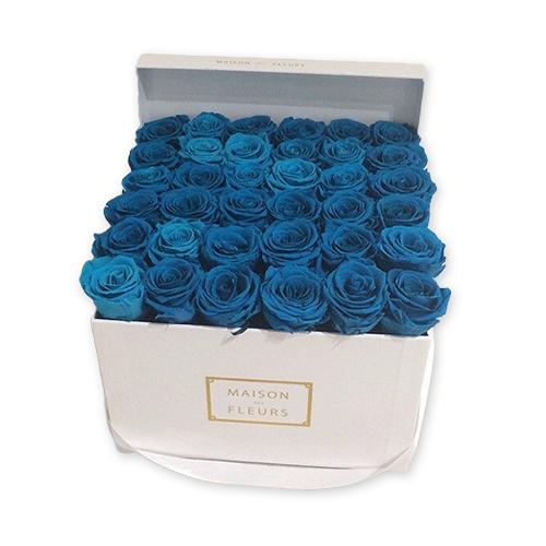 Синие цветы в коробке фото